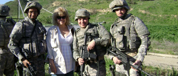 Terrorism book author with soldiers on the set of American Carol